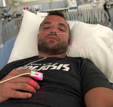 Nick. E Tarabay in a hospital bed.