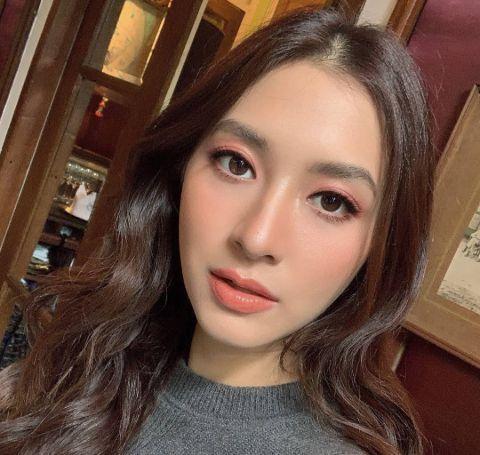 Nittha Jirayungyurn clicks a close-up selfie in a grey top.