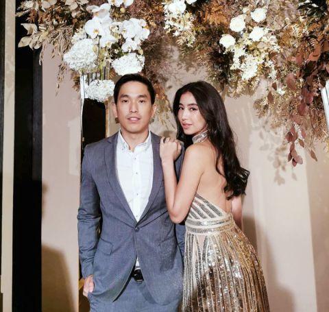 Chalida Vijitvongthong in a designer golden cloth with her boyfriend Pupaa Taechanarong at an wedding event.