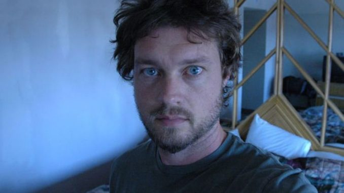 The multi-talented journalist Evan Ratliff clicks a selfie picture.