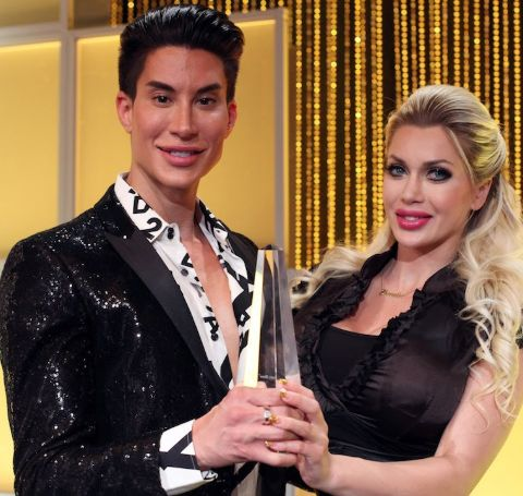 Justin Jedlica in black coat with Pixee Fox at an event.