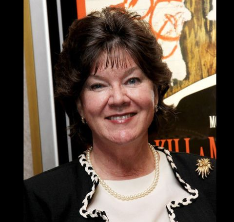 Mary Badham in a black and white dress.
