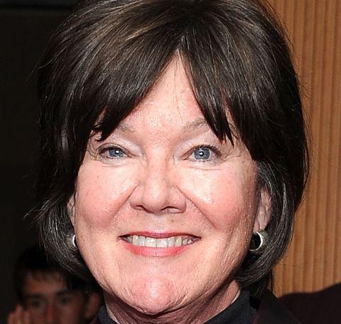 Mary Badham, black hair smiles at the camera.
