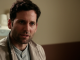 Eion Bailey caught on television acting wearing a grey coat.