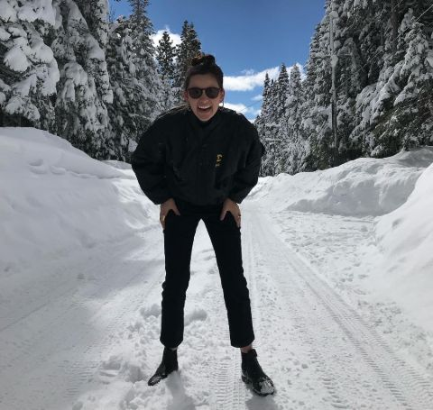Jacqueline Toboni all in black at a snowy hill.
