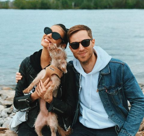 Laysla De Oliviera in black t-shirt and goggles with boyfriend Jonathan Keltz and dog.