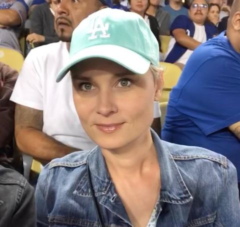 Kristina Klebe wearing a blue cap and jeans jacket.