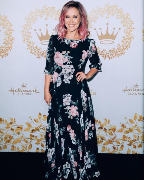 Emilie Ullerup in pink hair, and a gorgeous black dress.