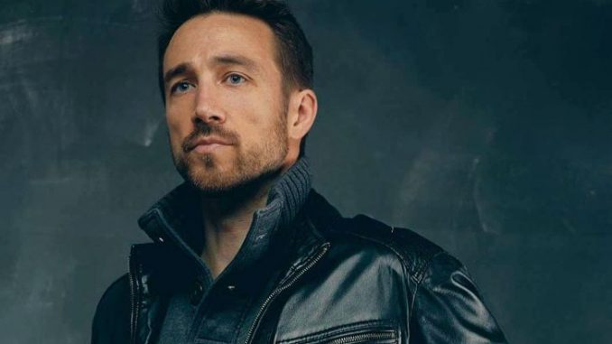 Brendon Zub in a black leather jacket.