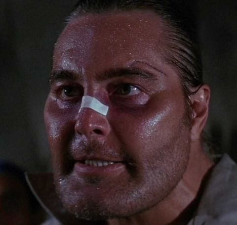 Robert Z'Dar with a tape in his nose.
