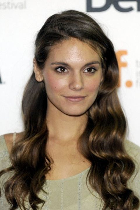 Caitlin Stasey giving a pose while attending an event.