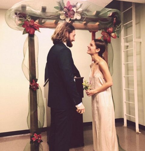Actress,Caitlin Stasey standing along with her husband, Lucas Neff at the time of their wedding.