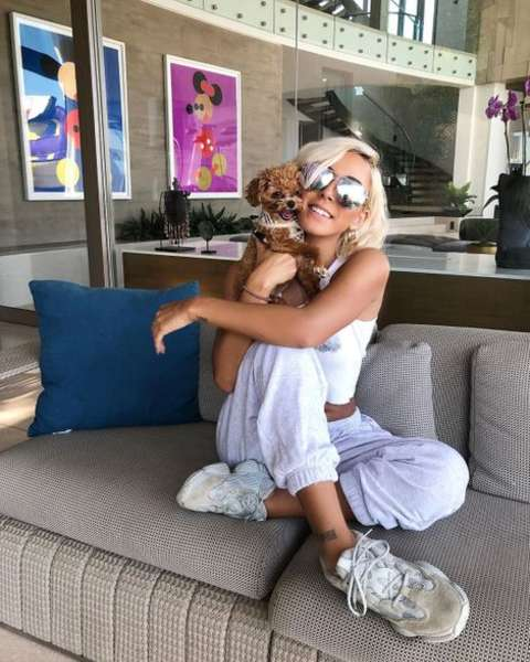 Instagram star, Tiffany Bondoc holding her pet dog.
