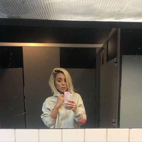 Tiffany Bondoc clicking a mirror selfie.