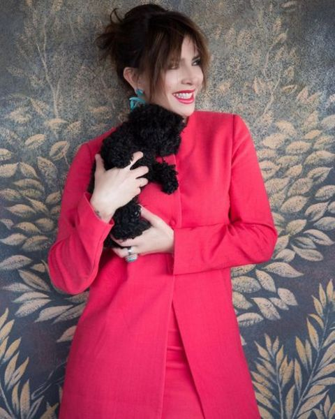 Francesca Rettondini holding her pet dog, Kiki.