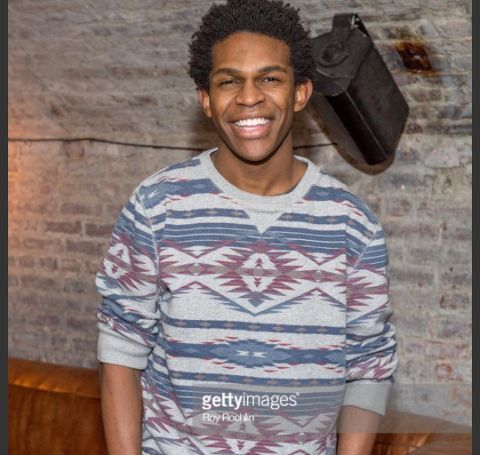 Camrus Johnson in a blue t-sweater.