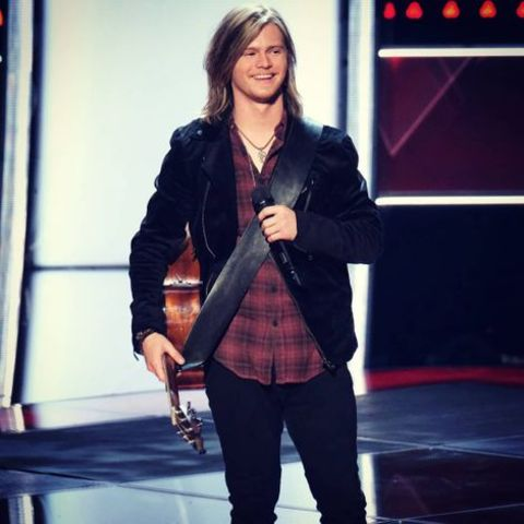 Jake Haldenvang holding his guitar at The Voice.