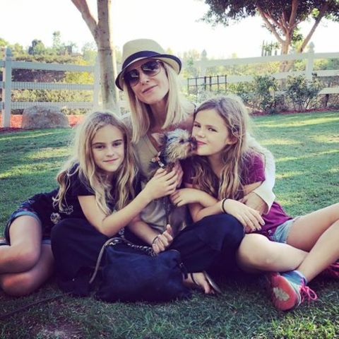 Actress, Tricia O'Kelley posing along with her daughters from married life with former husband and dog.