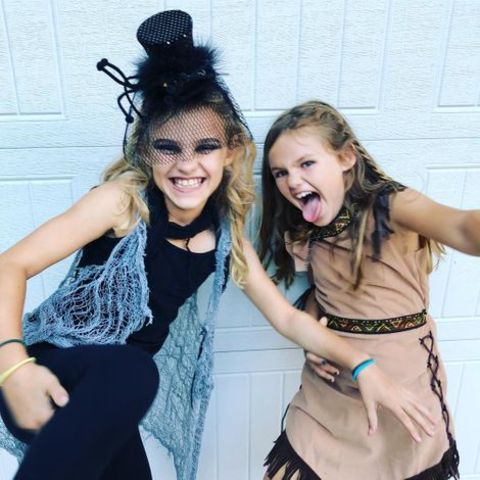 Adam Rosenblatt's two daughters, Avery and Charlie giving a pose.