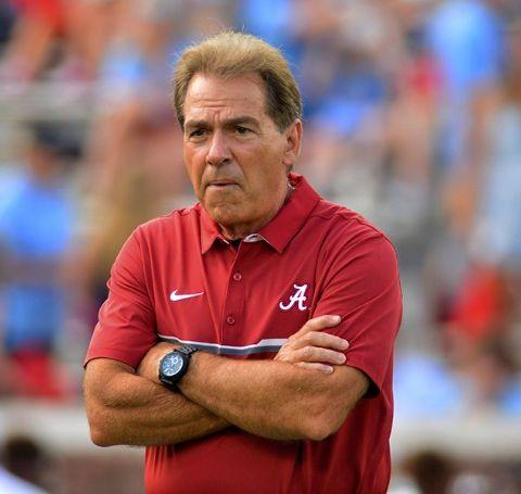 Nick Saban in a red t-shirt of Alabama.