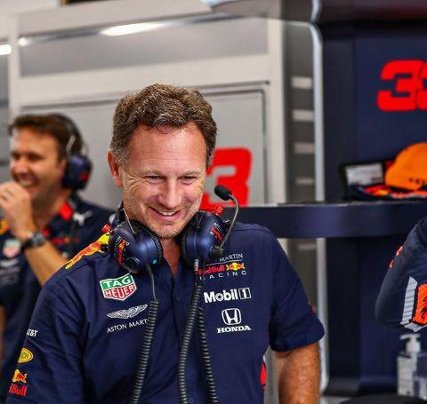 Red Bull Racing principal Christian Horner in a blue t-shirt of Red Bull Racing.