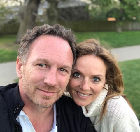 Christian Horner in black jacket takes a selfie with wife.