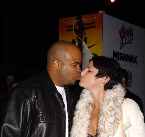 Natalie Raitano kissing her husband in an event.