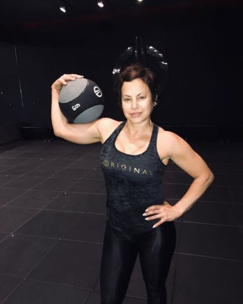 Natalie Raitano holding a gym ball.