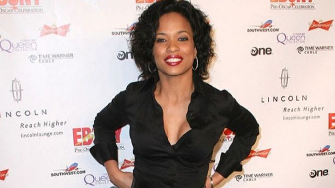Karrine Steffans in a black top at an event.