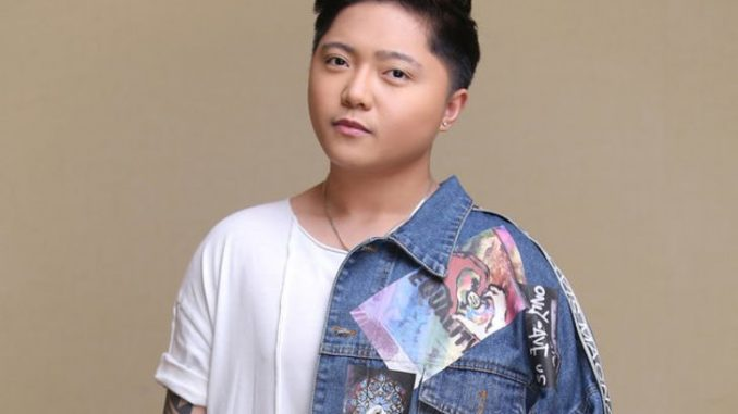 Jake Zyrus in a white-blue t-shirt.