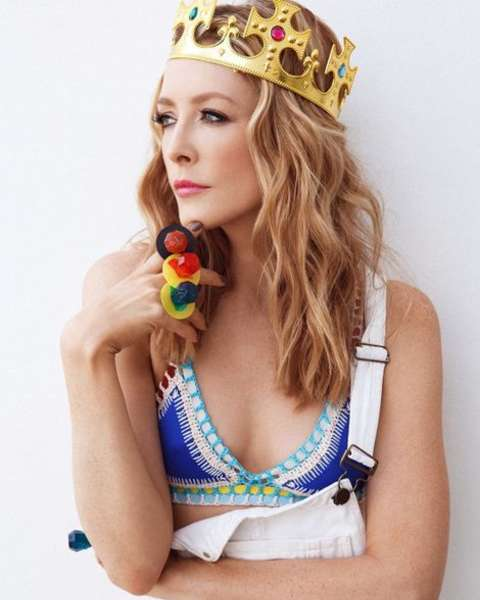 Actress, Jennifer Finnigan giving a pose while wearing a crown.