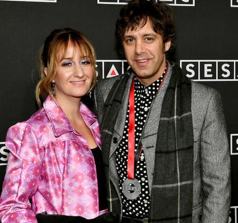 Jeremy Ivey in grey coat and  black muffler with wife Margo Price.