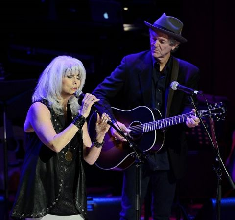 Emmylou Harris and her ex-husband Paul Kennerley performing at a concert.