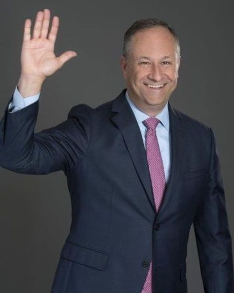 Lawyer, Douglas Emhoff waving a hand while giving a pose.