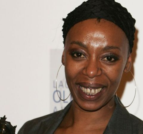 Noma Dumezweni in a black dress at an event.