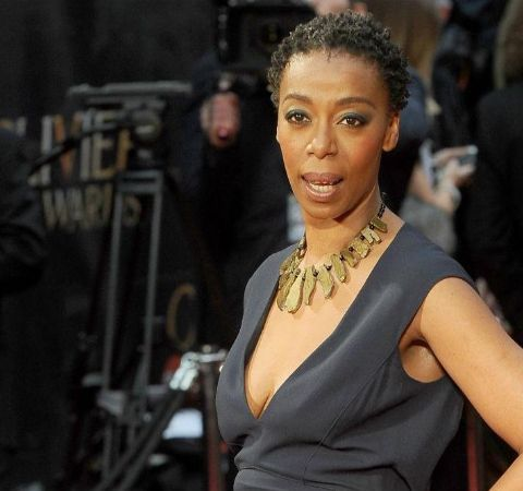 Noma Dumezweni in a dark dress poses at a award ceremony.