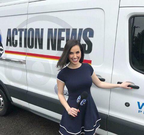Katie Katro poses in front of ABC Action News's van.