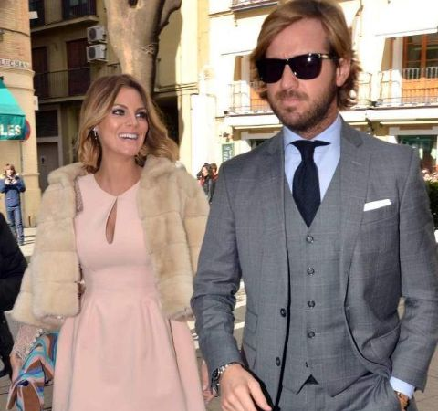 Rosauro Varo Rodriguez in a grey suit with wife Amaia Salamanca in pink dress.