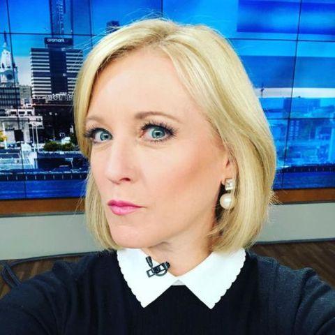 Sarah Bloomquist taking a selfie inside her office.