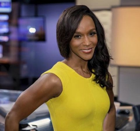 TaRhonda Thomas in a gorgeous yellow dress poses for a picture at 6Abc.