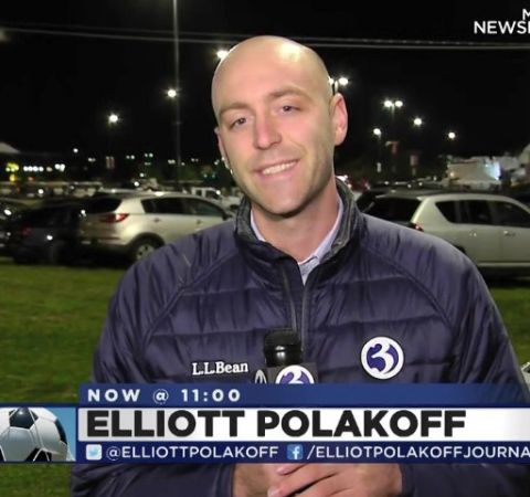 Elliott Polakoff in a black jacket reporting for Channel 3.