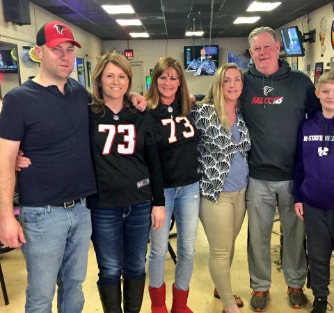 Elliott Polakoff with the family of Atlanta Falcons while reporting for Fox Kansas.