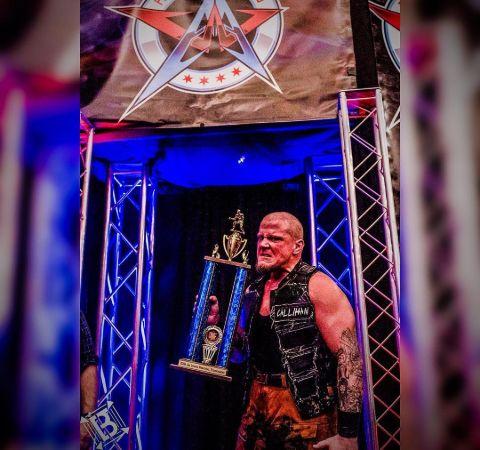 Sami Callihan poses with the trophy of Jim Lynam memorial tournament.