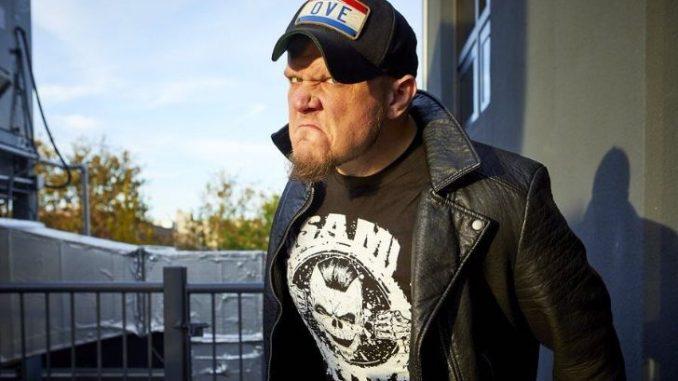 Sami Callihan in a black t-shirt and black cap.