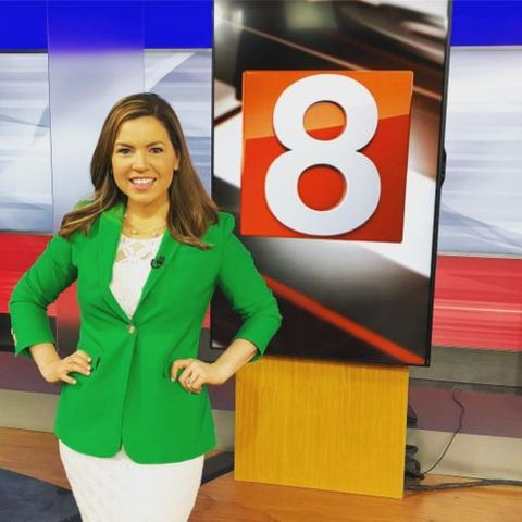 Stephanie Simoni giving a pose at her news studio.