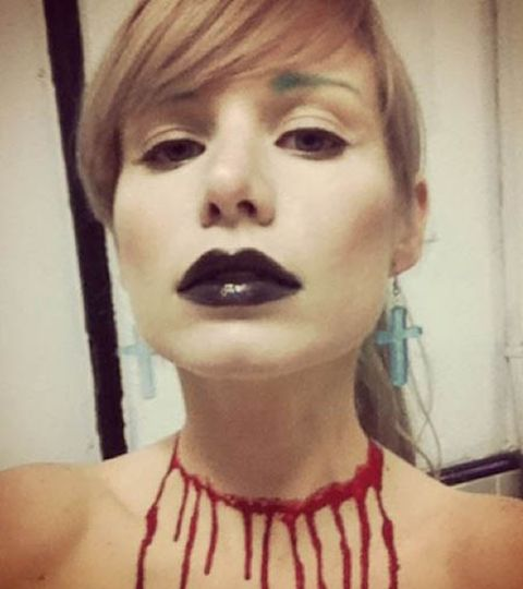 Elizabeth Ashley Wharton posted a picture in her Instagram with a nail polish art in her neck resembling a 3d tattoo of her neck getting slit by a knife.