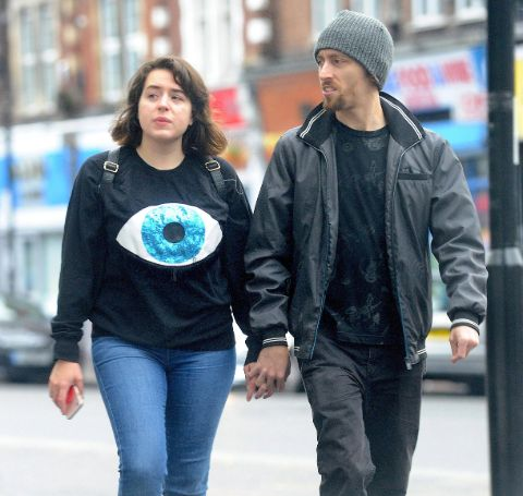 Max Parker in a black jacket with wife Isabella Cruise.