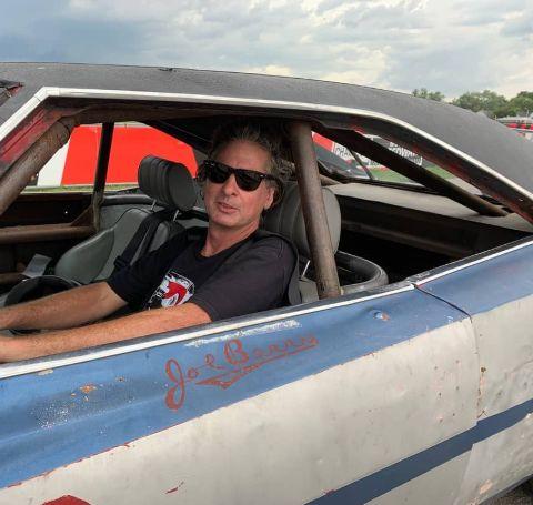 Steve Dulcich in a blue vintage car.