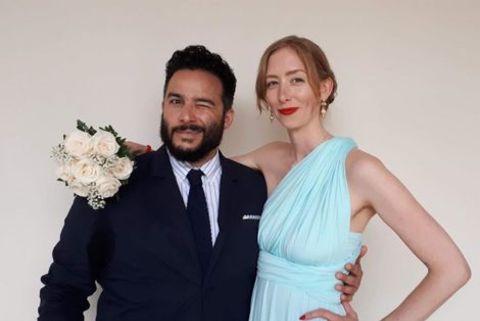 Ennis Esmer giving a pose along with his wife, Amye Blaxland.