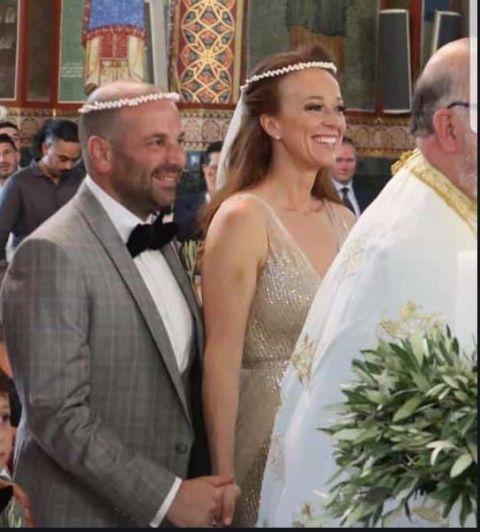 George and Natalie in wedding dress.